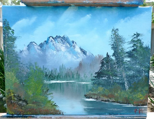 Painting of mountain with lake